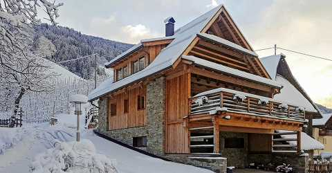 Chalet Obereggerhof with panoramic terrace in wintertime
